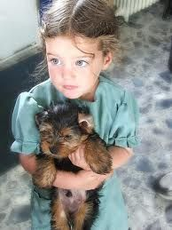 Amish girl with puppy