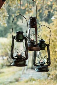 Light of Lanterns Old Lanterns, Antique Lanterns, Walk In The Woods, Cabins In The Woods, Cozy Cabin, Cozy Cottage, Chandeliers, Cabin Porches, Lantern Lamp
