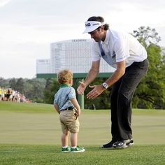 theaugustachronicle:  Bubba Watson celebrates with his son Caleb after winning the #Masters Tournament at #Augusta National #Golf Club on Su...