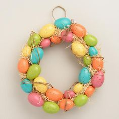The perfect Easter door decor, this exclusive wreath displays multi-colored spring eggs on a real twig base with raffia for added texture. >> #WorldMarket Spring, Easter Decor