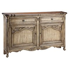 Hand-painted two-door sideboard with adjustable shelving and a solid wood top.  Product: SideboardConstruction Material: ...