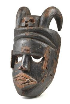 Ibibio, Nigeria: An old, large mask with horns and skull.