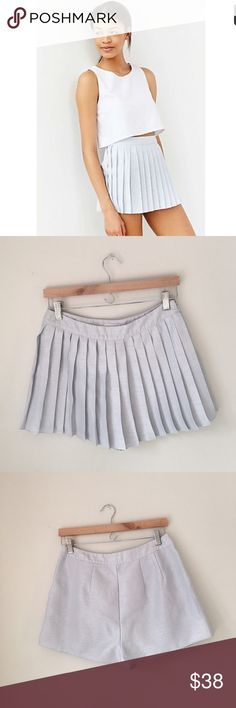 UO Silence + Noise Silver Pleated Eloise Skort Silver pleated 'Eloise' skirt by Urban Outfitter's Silence + Noise. Pleated front & smooth back. 100% polyester. Side zip. Size 4. EUC. Urban Outfitters Shorts Skorts