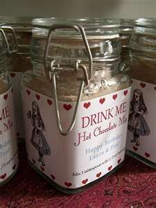 Hot Chocolate Alice in Wonderland favor idea.  Would be better in small ziplock bag for us though.