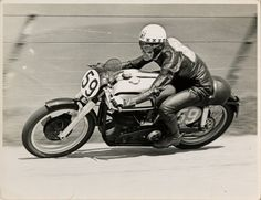 Ray Amm, TT (Tourist Trophy) rider, riding a Norton (number 59) Wall Art & Canvas Prints by T.M. Badger