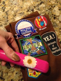 Use a flat (hair) iron to put Girl Scout patches on!  I do it all the time and it works.  My flat iron heats 430F.  Heats front and back, works so much better than a regular iron.  None if our patches have fallen off!!!!