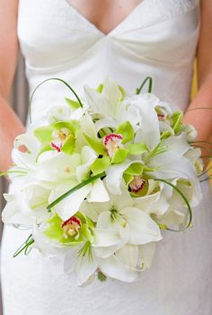 Bridal Bouquet Inspiration made of white lilies, green orchids and bear grass! LOVE!