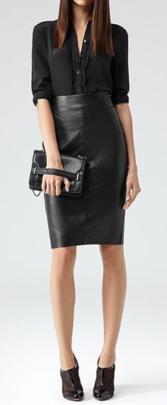 Pair a black leather pencil skirt with a black blouse and throw on a coat to complete the winter look.
