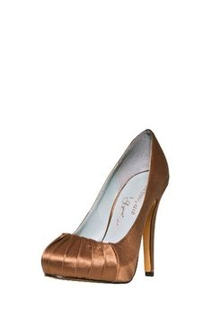 "Dance the night away in these covered-heel pumps -- the perfect complement to your evening-wear style.   - Almond toe  - Pleated front  - Covered heel  - Approx. 4.5"" heel, .75"" platform  - Imported  Satin upper, leather sole"