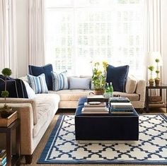 Light grey walls, beige sofa bold navy fabrics... Just add pops of coral and voila! Looveeeee it!