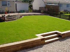 Terrace created with new timber sleepers and newly laid lawn and raised beds 5 Backyard Trampoline, Sloped Backyard, Sloped Garden, Backyard Garden Design, Small Garden Design, Backyard Patio, Backyard Landscaping, Patio Wall, Backyard Chickens