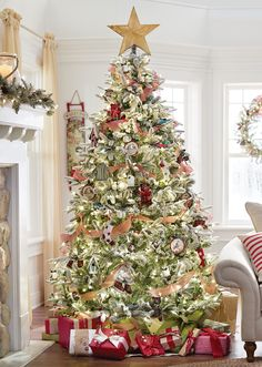 A snowy Christmas tree decked out in American traditional style. There's nothing that brings us more holiday cheer than this beauty. HomeDecorators.com #12DaysofDeals #holiday #christmastree