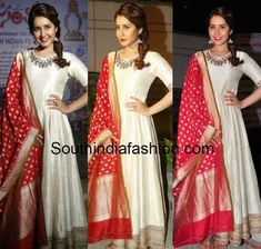 Raashi Khanna in White Anarkali – Raashi Khanna attended Santosham Awards anniversary curtain raiser event wearing a cream color zardosi embroidered anarkali paired with contrast red Indian Gowns, Indian Attire, Indian Ethnic Wear, Indian Outfits, Western Outfits, Indian Style, White Anarkali, Anarkali Dress, Lehenga