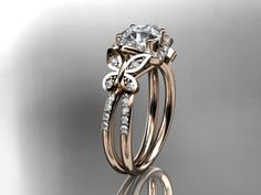 14kt Rose Gold Diamond Butterfly Wedding Ring I don't know if id want as a wedding ring but maybe just like a regular thing