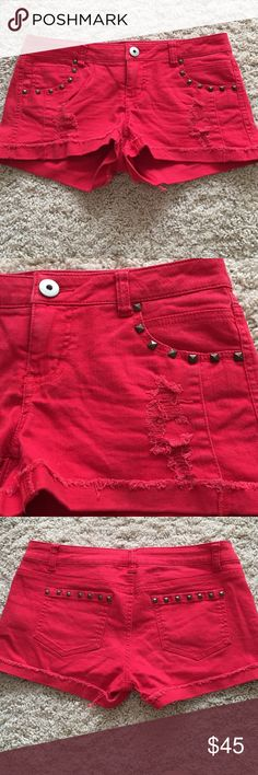 Studded red short shorts Studded red short shorts, barely worn!! Super cute and have a comfortable stretchy material. Xhilaration Shorts Jean Shorts