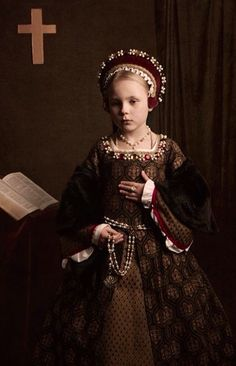 Mini me's, that how young children were dressed from a very young age, image of their parents attire. How restrictive these clothes must have been for children, different times though!
