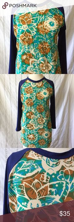 "LuLaRoe Randy T Shirt Top Floral Blue Brown Small New without tags Lularoe Randy Floral T-Shirt with 3/4 blue sleeves. In excellent condition. 96% polyester, 4% spandex  Small Measurements: Shoulder to Shoulder: 15"" Underarm to Underarm: 21"" Sleeve Length: 20"" Length: 27"" LuLaRoe Tops Blouses"