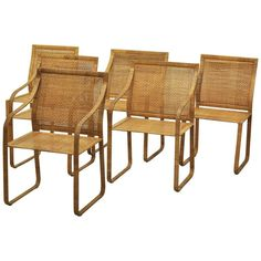 Set of Six Harvey Probber Woven Rattan Dining Chairs | From a unique collection of antique and modern dining room chairs at https://www.1stdibs.com/furniture/seating/dining-room-chairs/