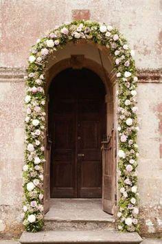 floral garland around door, creative, elegant and interesting use of flowers. #2015 #Wedding #Trend