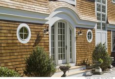 Shingle style home exterior detail.