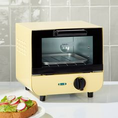 Dash Mini Toaster Oven + Reviews | Crate and Barrel Small Appliances, Kitchen Appliances, Kitchen Tools, Kitchen Stuff, Kitchen Supplies, Kitchen Items, Best Kitchen Gadgets, Dorm Kitchen, Kitchen Decor