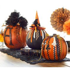 Add ribbon and embellishments to create these easy no carve Halloween Boo Embellished Pumpkins