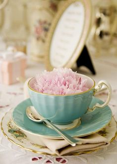 She collects pastel-colored tea cups and saucers. She fills them in half with water and a few drops of food coloring. She dyes white carnations all over her house.