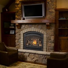 stone fireplace hmmm.. with a little fixin ours cd look like this