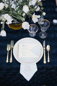 Black and gold place setting with flag menu