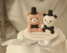 These are LOVE ANGELS wedding cake topper.^^  They are your love angels!^^ and will always keep their eye on you. ~^.^~ This listing is for lovely and cute Panda with base . included full veil .  the eyes are made by SWAROVSKI crystals, it looks more charming and elegant. please let us know is you want to have the SWAROVSKI crystalseyes, there will be the exytra charge ^^  The Panda stands approx. 6cm tall . Sweet heart approx 9cm width.   Please let me know: -- the colour of the suit…