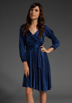 $207 on sale at Revolve Clothing; by Halston Heritage. A bit like Kate Middleton's engagement dress, no?