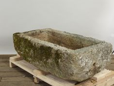 Large Antique Carved Stone Rectangular Trough, hand hewn from Cornish Granite. Typically antique stone watering troughs tend to be long and narrow, but this one is particularly wide and deep. Could be used as a fountain basin or planter. Well weathered with nice mossy growth. Good consistent proportions. Drainage hole on short side of trough. A wonderfully rustic old farming trough. With the natural stone and uneven bottom, we would suggest placing this trough on pea stone or crushed stone to le Pea Stone, Garden Ornaments For Sale, New England, Cornwall England, Trough Sink, Better Weather, Crushed Stone, Stone Carving, Farming