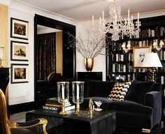 really enjoying just the small touches of gold in this living room.  Keeps it from feeling too 1992.