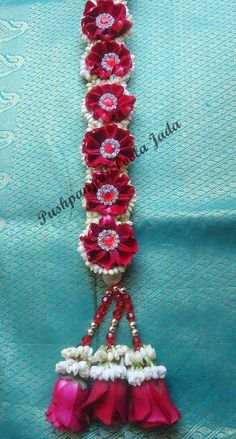 Poola jada with real jasmine flowers,red rose petals, and applique.