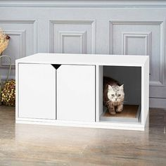 Don't you think it's time your cat went to bathroom in style?! We do and that's why Way Basics created this beautiful and modern looking litter box! A smart and attractive way to keep the litter hidden away. This sleek white cat litter box is functional for the cat and looks great in any room, we wouldn't be surprised if people didn't realize there was cat's litter in there. It contains two easy to open doors that your cat can walk in and walk out with ease. There is a large opening next to…