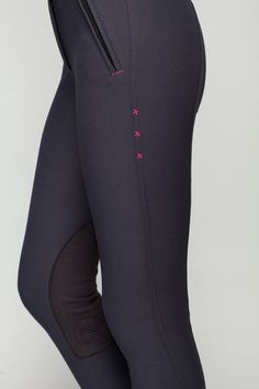 SCOUTED: Noel Asmar Equestrian's signature X stitching on the midnight navy knee patch breeches with hot pink trim