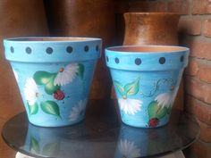 """10"""" and 8"""" Hand Painted Clay Pots -   sealed with 5 coats inside pot and outside pot f polyurethane - come in matching sets with galvanized cans and other garden accessories"""