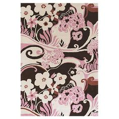 Stylishly anchor your living room or master suite with this lovely hand-tufted New Zealand wool rug, showcasing a whimsical floral motif in pink and brown. ...