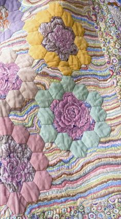 Glorious Color Hexies from Kaffe Fassett fabric.