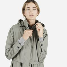 A lightweight anorak with a modern cut that's perfect for transitional weather 100% water-resistant polyester Features black trim throughout Hem has a subtle curve along the sides and front Double-sided front slant pockets Machine wash cold, tumble dry low