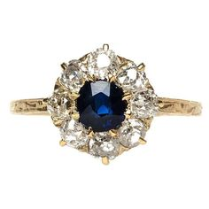 Victorian Sapphire and Diamond Halo Engagement Ring | From a unique collection of vintage engagement rings at http://www.1stdibs.com/jewelry/rings/engagement-rings/ #UniqueEngagementRings #haloring #halorings #engagementrings #vintagerings