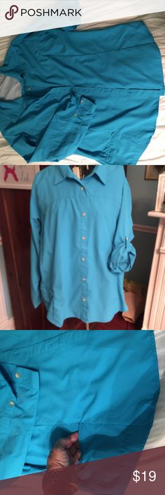 White Sierra Women's Outdoor Sports Blouse Beautiful silky polyester moisture wicking fabric in turquoise. Hidden zipper pocket on one side and sleeves can be worn long or rolled up and fastened with tabs. White Sierra Tops Button Down Shirts