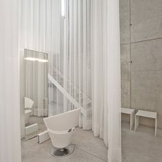 Fabric used as partitions.  Portuguese studio Nuno Capa