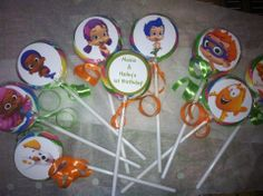 """Bubble Guppies Lollipop party favors. 12 2"""" swirl lollipops, personalized on the back of each one for your event. 12 or 16.50 plus 5.00 shipping"""