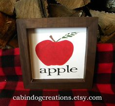 Decorate your home for Fall, Autumn , Halloween, Harvest and right through Thanksgiving with this cute painted apple picture. Each picture is hand painted in red and green on a white background with a dark brown stained frame. Painted Wood Signs, Wooden Signs, Hand Painted, Pumpkin Pictures, Fall Pictures, Distressing Painted Wood, Red Artwork, Apple Picture, Apple Theme