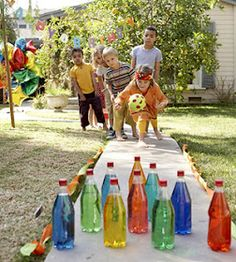 Make a backyard bowling alley. Add a few drops of food coloring to ten clear plastic bottles of water. Stand them up on flat ground, use party streamers as lane margins, and score a strike for saving cash.