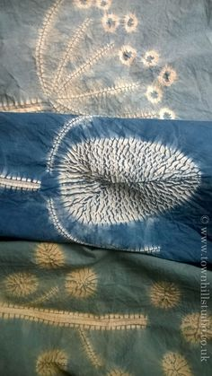 A selection of indigo dyed shibori stitch resist fabrics designed and made by Townhill Studio