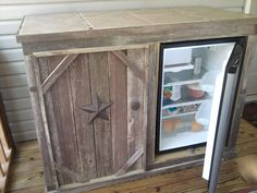 Deck cabinet with refrigerator. (open door) Tile top. -- make the other side hold paper plates and those things. I would just be nervous for bugs if you keep stuff in the fridge....maybe only keep canned or bottled drinks...