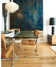 Modern elegant camel and blue dining room with statement pendant and timber flooring.