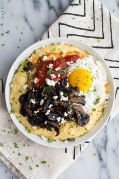 Polenta with Caramelized Mushrooms, Marinara, Fried Eggs & Goat Cheese | 33 Cuddly And Delicious Beds Of Polenta
